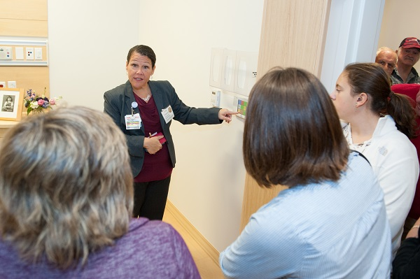 Nurse Manager describing new features in one of the new medical/surgical rooms