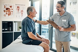 patient and physical therapist talking