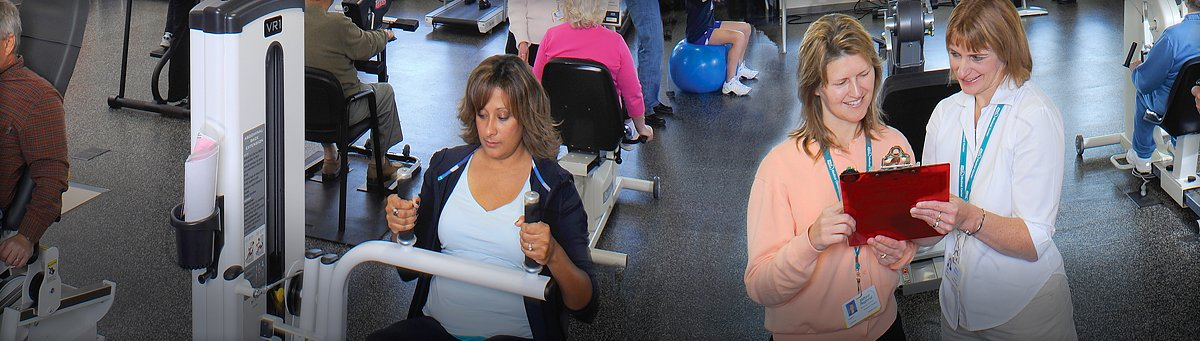 Women works out while medical staff looks at clipboard