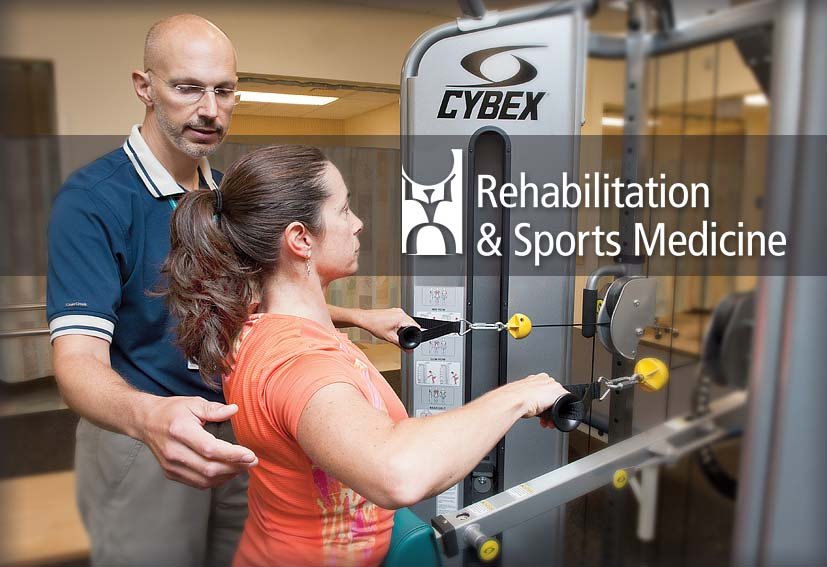 Rehab and sports medicine manager working with physical therapy patient